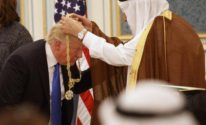 King Salman presents Trump with Saudi Arabia's top civilianhonor